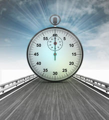 highway with shiny stopwatch with sky flare