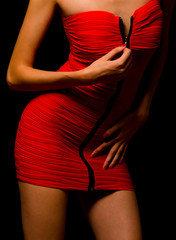 Lady in red dress undressing