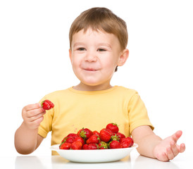 Little boy with strawberries