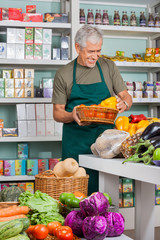 Salesman Working In Grocery Store