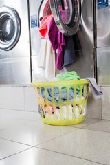 Overloaded Washing Machine And Laundry Basket
