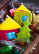 Colorful cookies and xmas tree decoration in wooden gift box