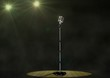 Vintage Microphone with Spotlights on Stage
