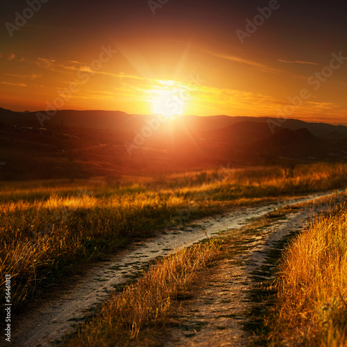 Dramatic sunset over autumnal valley, natural landscape