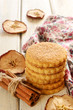 Pile of apple cookies with cinnamon on wooden table