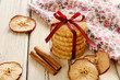Pile of apple cookies tied up with ribbon and bow on wooden tabl