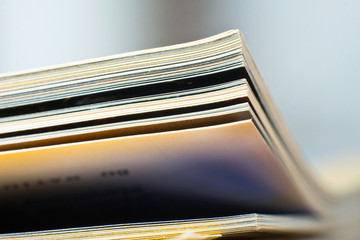 Close-up of magazine pages. Shallow DOF, focus on edges.