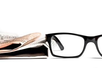 glasses near financial newspaper