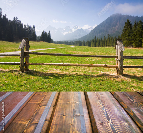 Mountains landscape with wooden planks