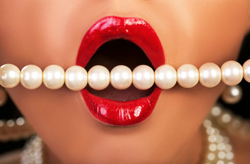 Sexy mouth with red lipstick and luxury pearls