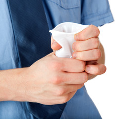 Hands crumpling paper cup