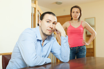 Middle-aged couple after quarrel at home