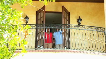 Mature Ethnic Couple Balcony Planning Day