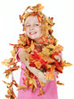 Pretty girl with leaves in autumn