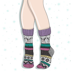 Woman wearing a pair of wool socks. Cute winter background.