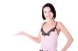 Beautiful slim woman in lingerie presenting copy space.