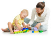 child boy and his mother play together with construction set toy