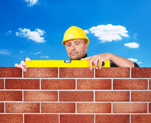 Bricklayer working at the building site