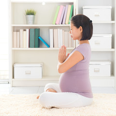 Relax pregnant woman meditating at home