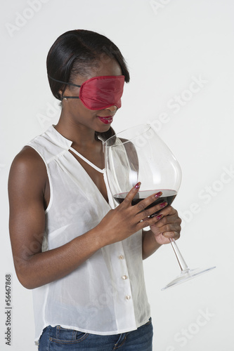 Blind tasting red wine in large glass