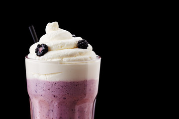 Fresh blackberry milkshake close-up