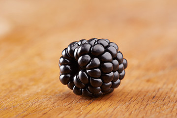 Single blackberry on table