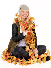 Woman with leaves shows autumn