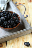 garden fresh juicy blackberries on old tray