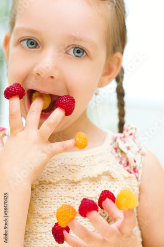 child with raspberry