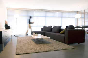 interior of a modern house with black sofa
