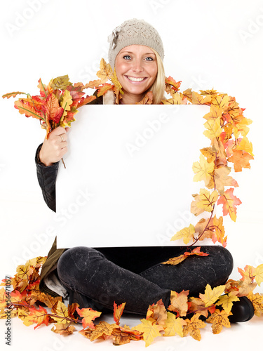 Woman with message board in autumn