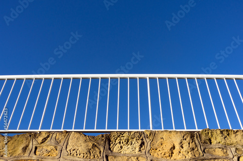 white railing against blue sky