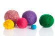 colorful different thread balls. wool knitting on white backgrou