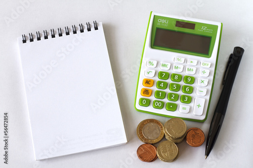 Calculator Notebook and Pen on White Background.