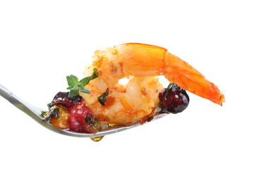 fork with a fried shrimp and berries isolated on white