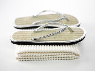 Flip-Flops mit Handtuch