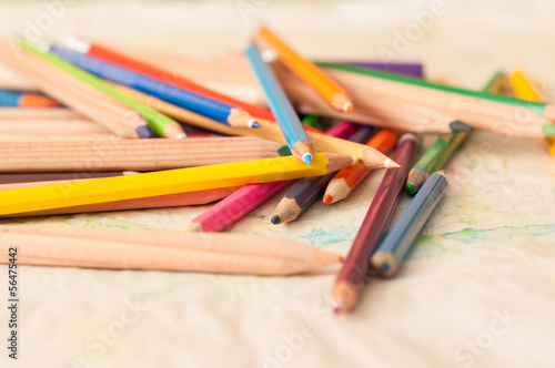 Coloured pencils scattered on a table. crayons