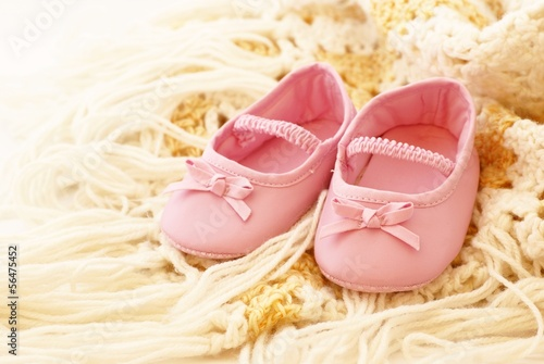 Baby pink shoes on blanket
