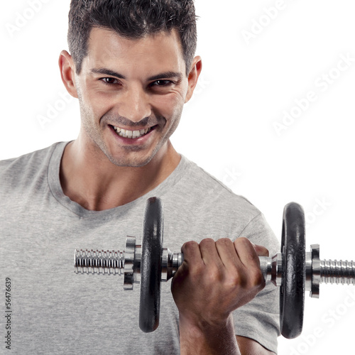 Athletic man lifting weights