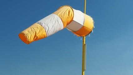 Windsock on the blue sky