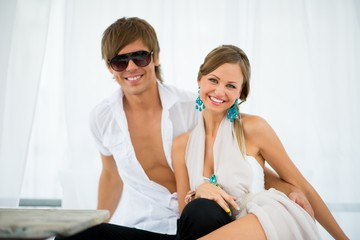Sexy young couple relaxing under summer awning