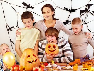 Family on Halloween party with children.