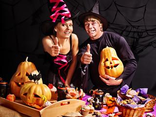 Couple on Halloween party .