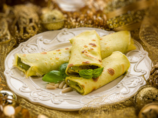 pesto crepes over golden christmas table