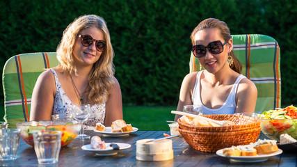 Two women enjoying garden party