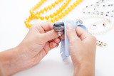 Polishing silver jewellery with a cloth - 56480861