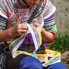 Woman making traditional clothes by hand