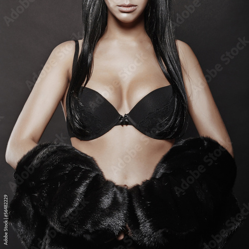 beautiful sexy woman in a fur and black lingerie