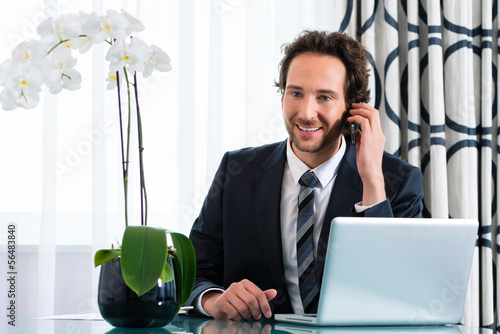 businessman in hotel is on the phone
