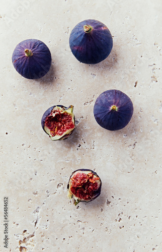 Still life with ripe figs on stone background
